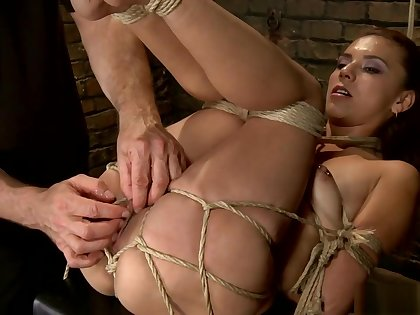 Tied Latina rides toy and gets flogged