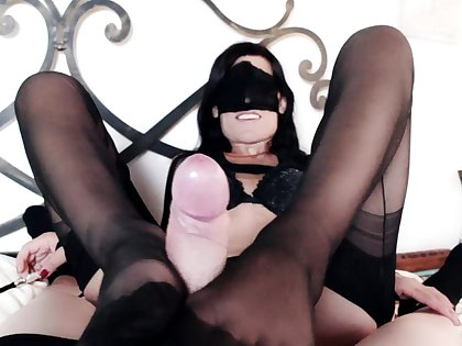 Lady Marilyn accomplishments her slave with a footjob and blowjob